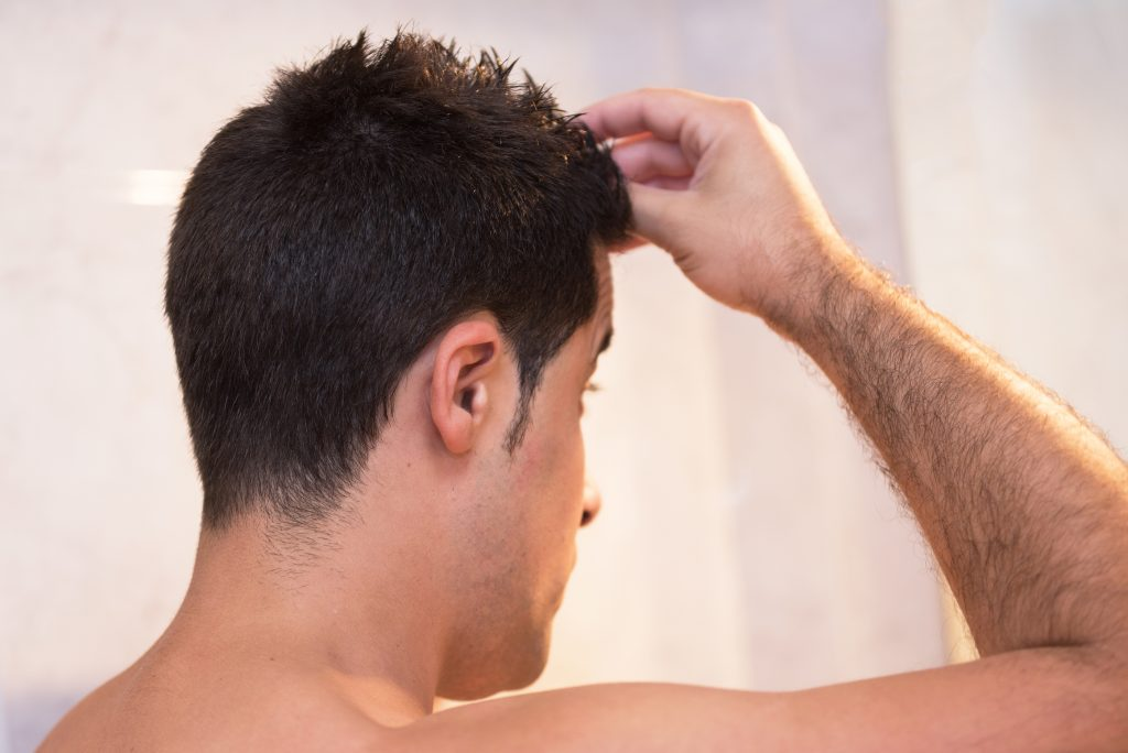 Man Combing Hand in Hair